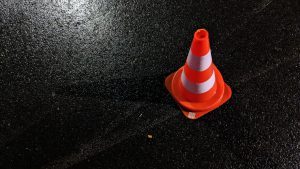 traffic cone on a wet road