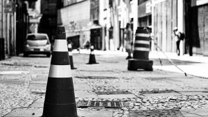 black and white image of traffic cones